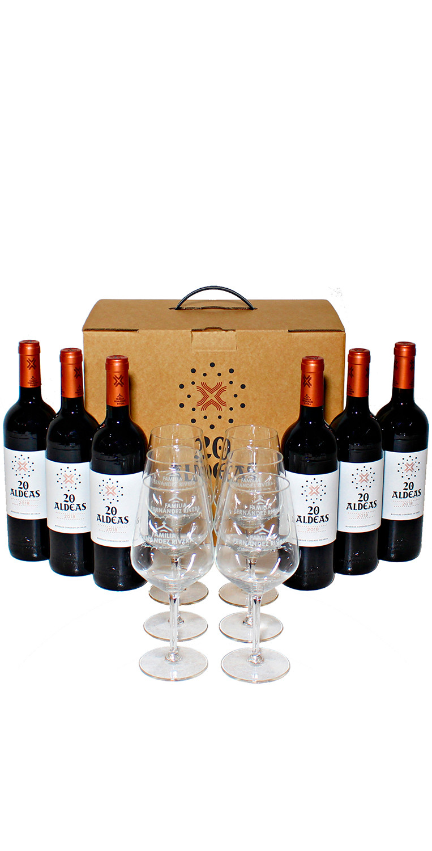 Bodegón compuesto por el pack de 6 botellas de 20 Aldeas, más 6 copas de vino serigrafiadas, en caja de cartón decorada